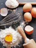 Dough preparation. Baking ingredients: egg and flour. Royalty Free Stock Images
