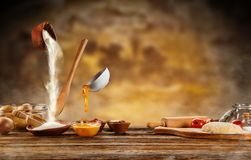 Dough preparation, baking ingredients placed on wooden table Stock Photos