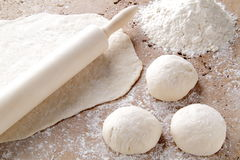 Dough for the preparation of home-made pizza Stock Photography