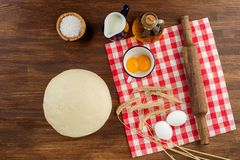 Dough preparation recipe bread, pizza, pasta or pie ingridients, food flat lay on kitchen table background. Text space Royalty Free Stock Image