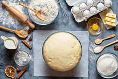 Dough preparation recipe bread, pizza or pie making ingridients, food flat lay on kitchen table. Background. Working with butter, milk, yeast, flour, eggs Royalty Free Stock Photos