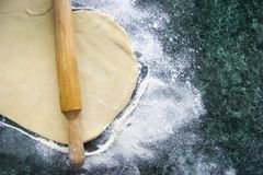 Dough on a floured marble green table, top view royalty free stock photography