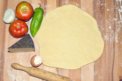 Dough raw pizza with vegetarian ingredients Royalty Free Stock Photos