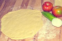 Dough raw pizza with vegetarian ingredients Stock Photos