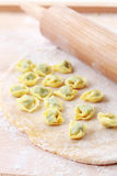 Dough with raw tortellini Stock Images