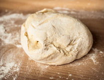 Dough_8. Raw dough on the wooden board Royalty Free Stock Photo