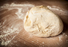 Dough_9. Raw dough on the wooden board Royalty Free Stock Image