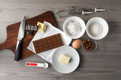 Dough recipe for baking chocolate cookies or cake,  ingredients for biscuits white, dark and milk chocolate, egg, flour, butter Royalty Free Stock Images