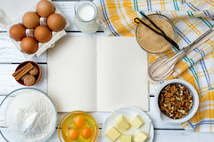 Dough recipe ingredients. Baking cake in rural kitchen - dough recipe ingredients (eggs, flour, milk, butter, sugar) on white wooden table from above Royalty Free Stock Photography