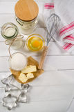 Dough  recipe ingredients eggs, flour, milk, butter, sugar and rolling pin  from above. Royalty Free Stock Photo