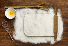 Dough recipe ingredients like eggs, flour on white Royalty Free Stock Photo