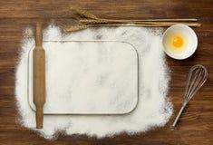Dough recipe ingredients like eggs, flour on white Stock Image