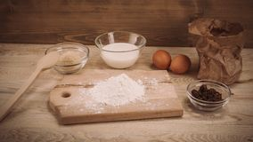 Dough recipe ingredients on vintage rural wood kitchen board Stock Image
