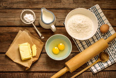 Dough recipe ingredients on vintage rural wood kitchen table Stock Images