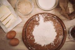 Dough recipe ingredients on vintage rural wood kitchen table Royalty Free Stock Photos