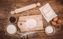 Dough recipe ingredients on vintage rural wood kitchen table Stock Photo