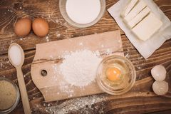 Dough recipe ingredients on vintage rural wood kitchen table Stock Photos
