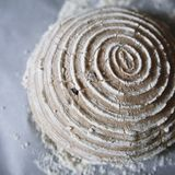 Dough removed from a banneton. Sourdough removed from a fermenter Royalty Free Stock Photo