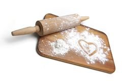 Dough roller, board and flour Stock Photography