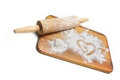 Dough roller and flour Stock Photos