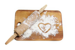 Dough roller and flour Stock Image
