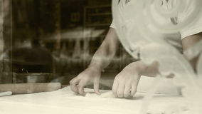Dough roller-pin strudel making process old film effect Royalty Free Stock Photography