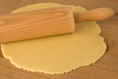 Dough with rolling pin Royalty Free Stock Photos