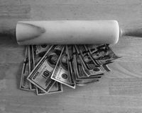 Dough and a rolling pin B&W. One Hundred Dollar bills, dough, under a marble rolling pin Stock Photography