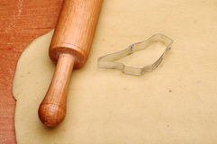 Dough, rolling pin and cutter Stock Photography