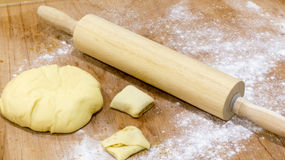 Dough with rolling pin Royalty Free Stock Photography
