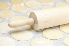 Dough and rolling pin with flour on the table Stock Photos
