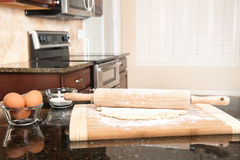 Dough and rolling pin in kitchen Royalty Free Stock Image