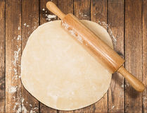 Dough with rolling pin Stock Images