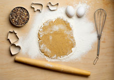 Dough with rolling pin on the wooden table. Kitchen background Royalty Free Stock Photos