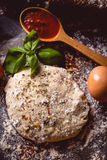 Dough with spices is being prepared to bake Royalty Free Stock Photos
