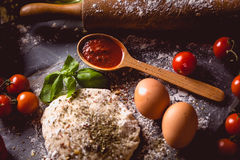 Dough with spices is being prepared to bake Stock Photography