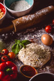 Dough with spices is being prepared to bake Royalty Free Stock Photo