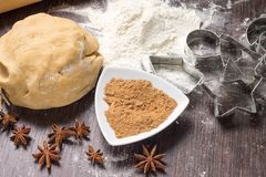 Dough with spices and cookie cutters Stock Photo