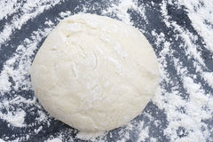 Dough sprinkled with flour. Royalty Free Stock Image