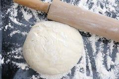Dough sprinkled with flour. Stock Photos