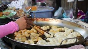 Dough stick in Thai market stock video footage
