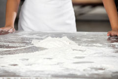 Dough On Table With Baker Standing In Bakery Royalty Free Stock Photos