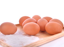 Dough and the tray of eggs on a floured table. Stock Photo