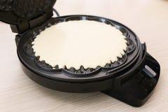 Dough on waffle iron Royalty Free Stock Images