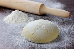 Dough With Rolling Pin And Flour Stock Images