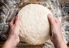 Dough_15. Woman's hands knead the dough Royalty Free Stock Photography