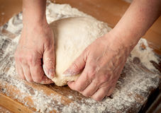Dough_16. Woman's hands knead the dough Royalty Free Stock Photo