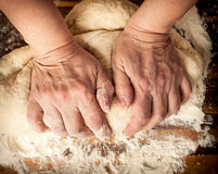 Dough_20. Woman's hands knead the dough Royalty Free Stock Photos