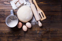 Dough on wooden background Royalty Free Stock Photo
