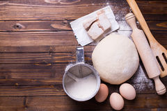 Dough on wooden background Royalty Free Stock Photography